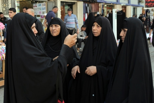 Iraqis taking photo with a phone